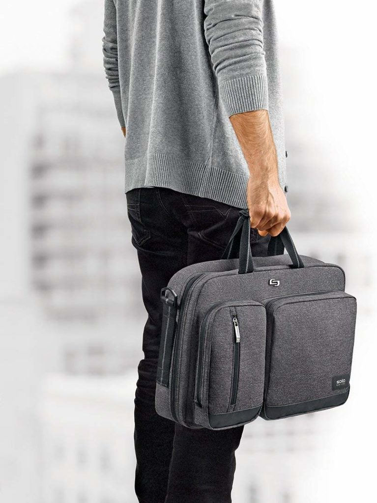 A backpack briefcase being lifted by its horizontal top handle